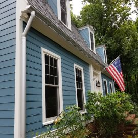 <p>Raleigh James hardie siding with Vytex Windows and Barrel gutters anodized.</p>